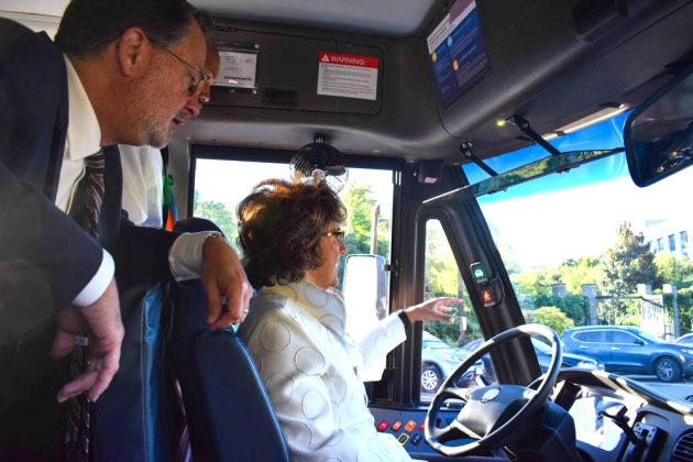 U.S. Sen. Peters (left) and Rep. Jackie Walorski (R-Ind.) (right) tried out the features of a school bus.