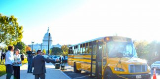 A bipartisan group promoted School Bus Safety Week by highlighting efforts to prevent illegal passing. Shown are Reps. Walorski and Brownley, with Chris Akiyama from Safe Fleet in the foreground.