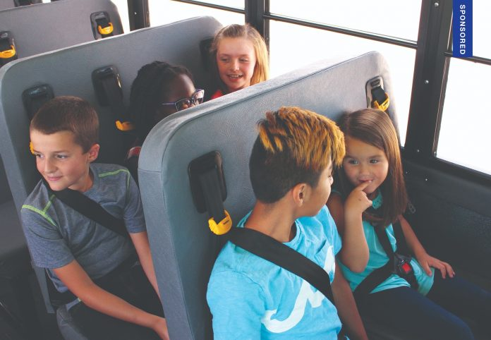 students buckled into seatbelts on a school bus