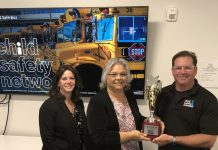 From left to right: Andrea DiSpirito, TSA, Susan Miller, state director of pupil transportation, and Ward Leber, founder of Child Safety Network, after Leber awarded Miller with an award for her school bus security efforts in Colorado.