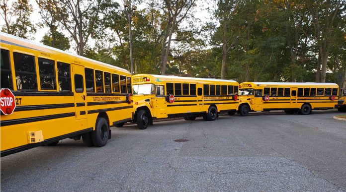 The four new Blue Bird Vision all-electric buses arrive at Bay Shore School District. Photo by Krystyna M. Baumgartner, public relations specialist at Bay Shore School District.