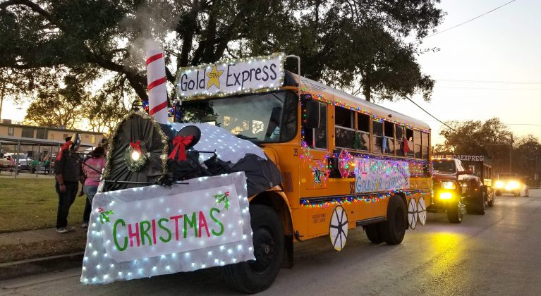 A Navasota, Texas decorated Christmas bus, complete with smoke rising from the smokestack.