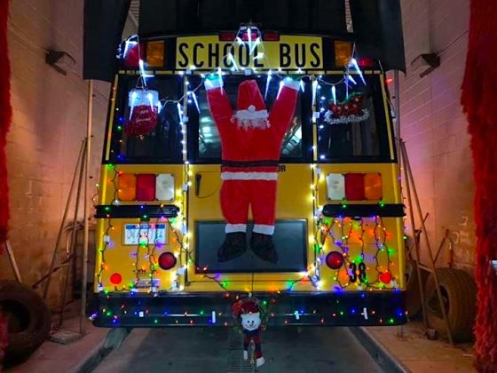 Santa is hanging on for dear life in one of the photos that Annita Kakale submitted of the Farmington Michigan Light up the Grand Parade school bus.