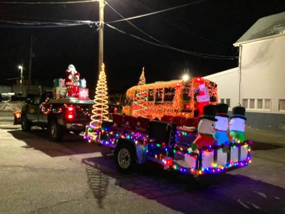 The team in Butler, New Jersey, was feeling jolly during their local holiday parade that featured this completely light-covered school bus.