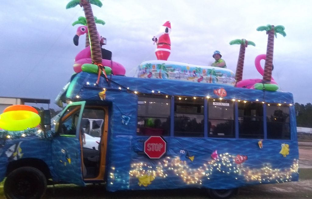 In Nashville, Georgia, Marie Cook reported that their Christmas parade theme was Christmas in the South, which was depicted with Hawaiian shirts because it was warm outside. Their float also received an Honorable Mention by the local Chamber of Commerce.