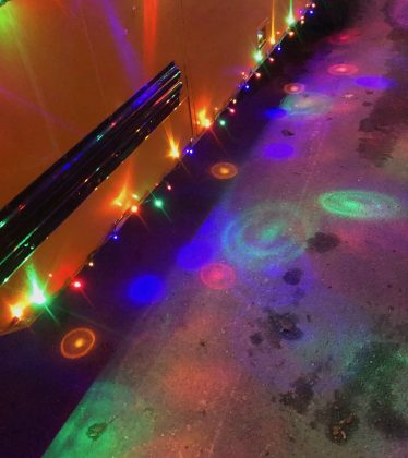 This Boulder school bus provided a colorful set of light patterns surrounding it.