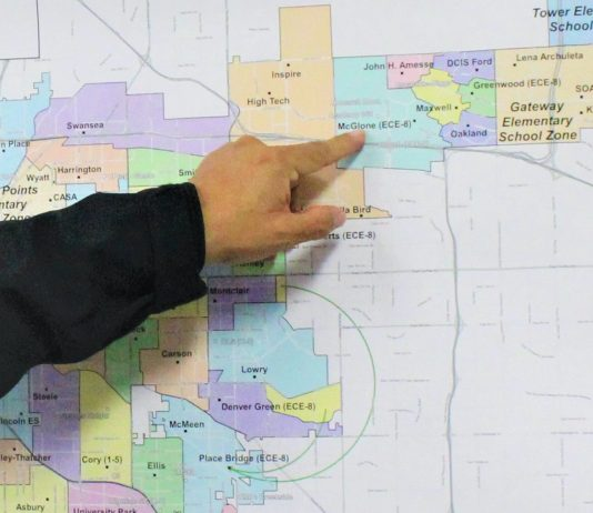 Albert Samora, Denver Public Schools' executive director of transportation, points to the northeast neighborhood where the Success Express shuttle program runs.