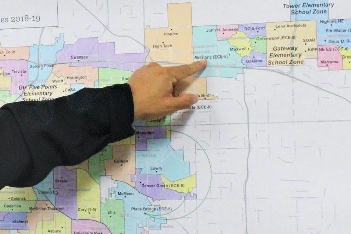 Albert Samora, Denver Public Schools' executive director of transportation, points to the northeast neighborhood where the Success Express shuttle program runs.