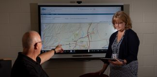 Jeff Wainwright, assistant transportation director, and Cheryl Dalton, director of transportation, review routes for Saratoga Springs City School District in New York. Photo courtesy of Tyler Technologies.