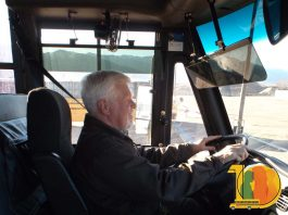 Dave Hartzell, director of transportation for Harrison School District 2 driving a school bus.