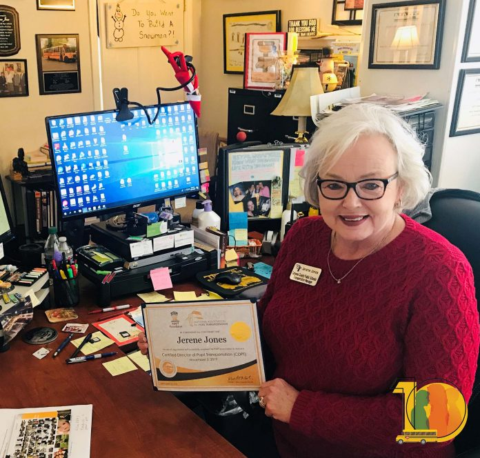 Jerene Jones, Transportation Manager at Catoosa County Public Schools, poses with NAPT Certified Director of Transportation certificate in her office.
