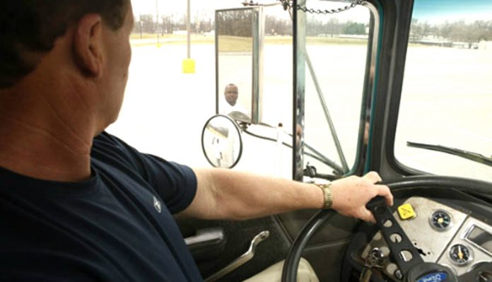 An entry-level school bus driver performs behind-the-wheel training. (Image courtesy of FMCSA.)
