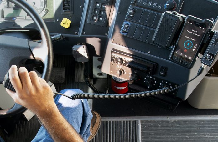 A schoolbus driver from the Pecos-Barstow-Toyah ISD has a Sonim rugged device docked on his bus. The district deployed FirstNet Ready Sonim rugged devices for the bus drivers for better connectivity and reliability.