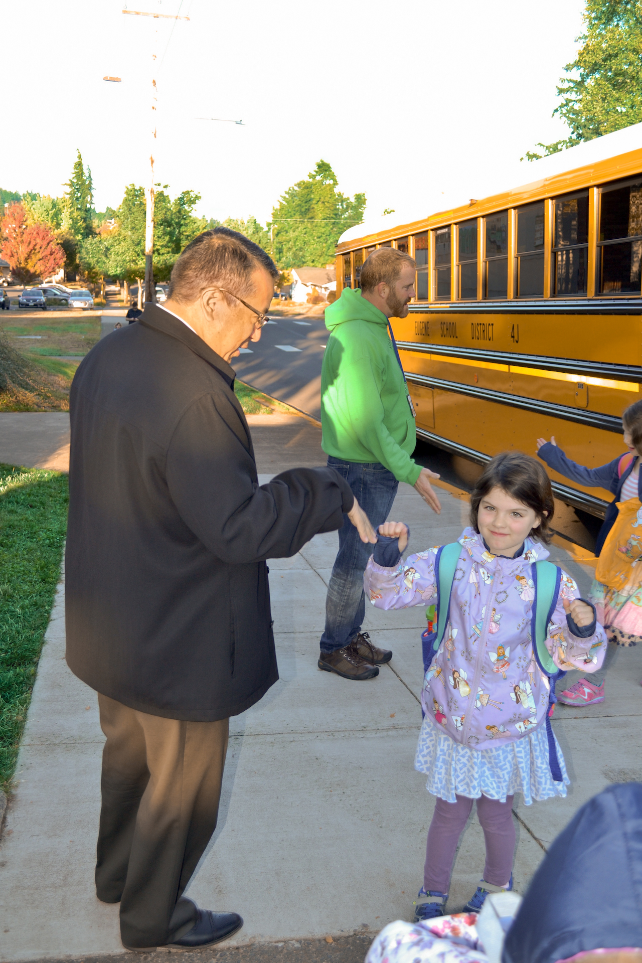Gustavo Balderas, superintendent for Eugene School District 4J, and a student about to board a school bus.