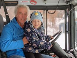 Wisconsin school bus driver Rick Krause with student Arianna Peggs. Krause said he loves developing caring relationship with his students and their parents. Facebook/Parenting the Principal.