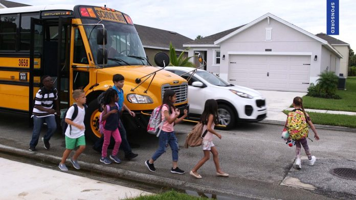 Students unloading from school bus