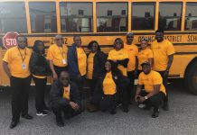 Transportation staff members at Orange County Public Schools in Florida pose with a school bus during the Love the Bus event on Tuesday, Feb. 4, 2020. The event is hosted by the American School Bus Council every year. (Photo courtesy of Kim Frye.)