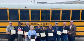 Transportation staff at Kanawha County Schools, West Virginia. From left: Jimmy Lacy, Willie Schofield, Billy Wiseman, Nancy Fields, Mary Slate, Tricia Jarrell, Laura Childress, Warren Reynolds, Wade Carnell, and Tommy Young of the state Department of Education.