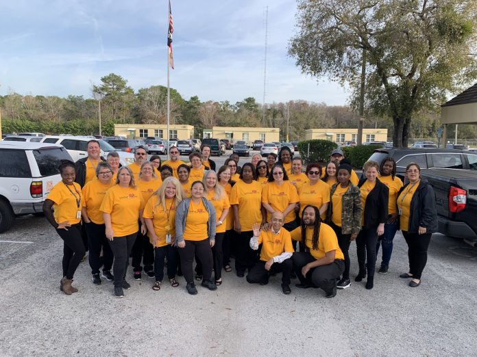 Transportation staff at Orange County Public Schools in Florida poses during the Love The Bus event in 2020. (Photo courtesy of Kim Frye)