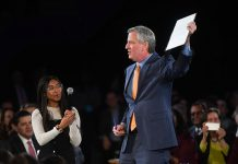 Mayor Bill De Blasio displays an executive order he signed during his State of the City address on Thursday, Feb. 6, 2020. (Photo courtesy of New York City Mayor's Office.)
