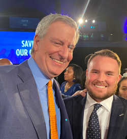 Mayor Bill De Blasio with Corey Muirhead, executive vice president for Logan Bus & Affiliates, at the State of the City event on Thursday, Feb. 6, 2020. Logan Bus is one of several dozen school bus contractors operating in the city.