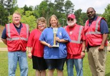 Newton County School Superintendent Samantha Fuhrey, second from left, congratulates 2019 district school bus roadeo winner Karen Jenkins. At far left is Director of Transportation Chad McCaskill. Randall Luna, transportation coordinator (second from right) stands next to David Flanigan, school bus safety and training supervisor.