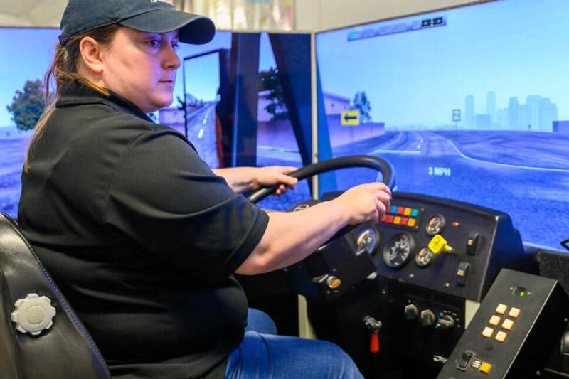 Klein ISD school bus driver Rashelle Wisnoskie takes the simulator for a spin. (Photo courtesy of Klein ISD)