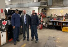 Mineola Public Schools Superintendent Michael Nagler, center, meets with school bus mechanics Greg Glover, left, and Greg Sabator right, at the district's garage.