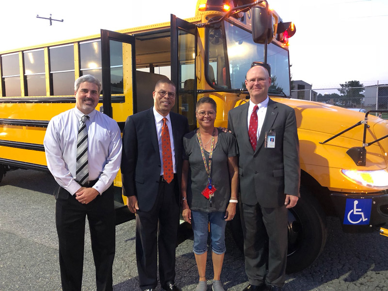 From left: Dr. Daniel Bowling, chief operations officer; Dr. Jeffery O. Smith; school bus driver; and school board member Joseph Kilgore.