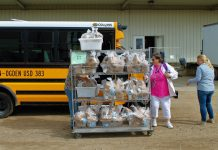 Schools in Kansas are closed due to the coronavirus impact, but school transportation operations are delivering meals to students in need. Photo courtesy of Lauren Jackson/Angel Inspired Photography.