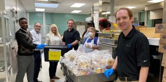 ALC Schools staff picks up food at Hickman Mills School District in Missouri for delivery to students.