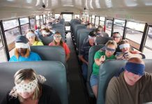 School bus drivers at Dean Transportation in Michigan wear blindfolds as one of their coworkers drives the school bus. The empathy training helps the drivers to understand the challenges that students with disabilities might be facing while in the school bus environment. (Photo courtesy of Fred Doelker)