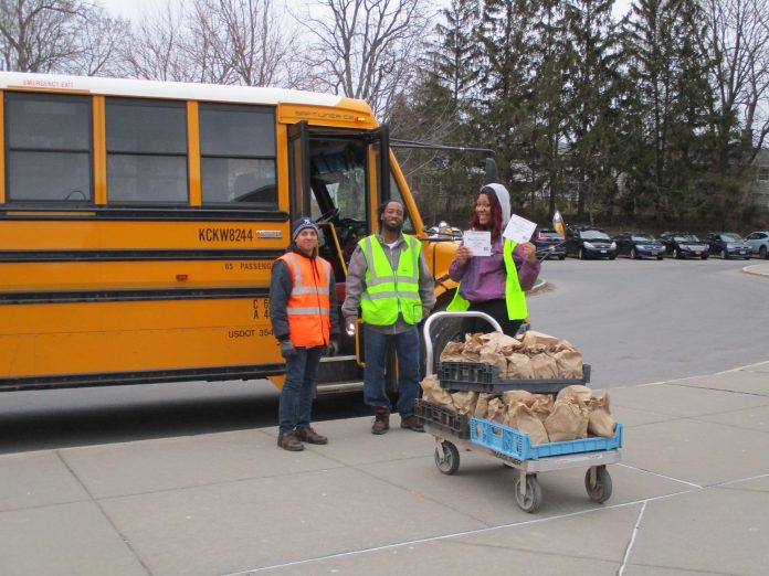 First Student school bus drivers in Syracuse, New York, deliver meals during the coronavirus pandemic.