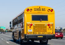 Stock photo of a school bus traveling down a highway near San Francisco.