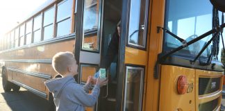 An Evergreen Public Schools bus in Washington state delivers a meal to a homebound student during COVID-19 closures.