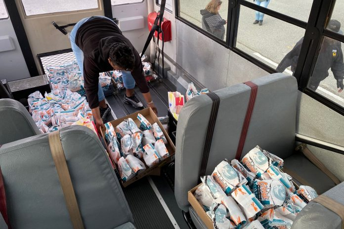 An employee of Suffolk Public Schools in Virginia organizes meals to be delivered to students during COVID-19 school closures. Facebook/Suffolk Public Schools