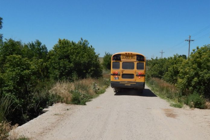 A school bus traversing a wooden bridge on the Pine Ridge Reservation in North Dakota. Source: U.S. Government Accountability Office