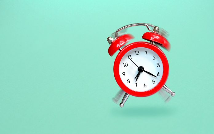 Ringing and bouncing red alarm clock background