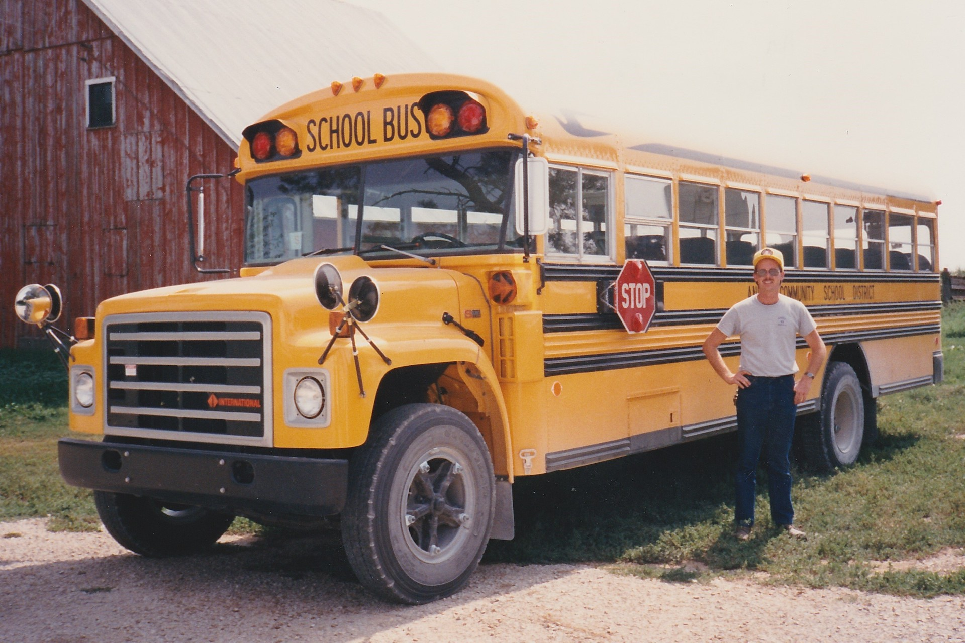Max Christensen posing with his second school bus at Anita Community Schools in 1988.