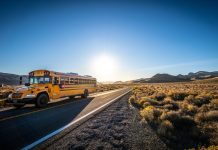 School bus driving down a road
