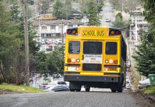 A school bus travels down a hill in Seattle.