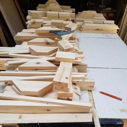 Pieces of cut wood are ready to be assembled into a desk. (Photo courtesy of Michelle Minor.)