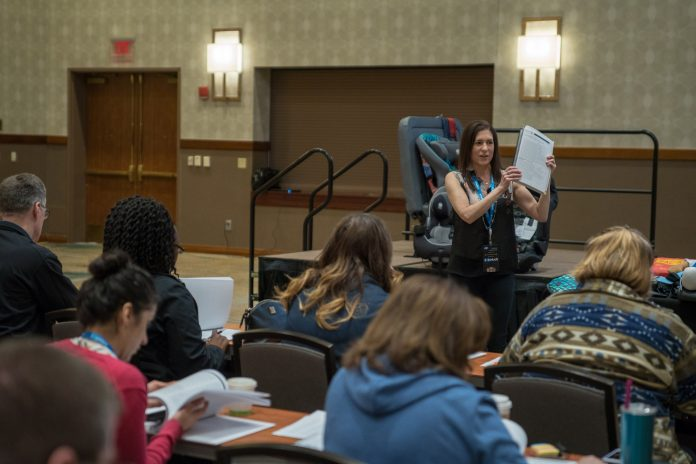 Denise Donaldson, shown above teaching a chapter of the Child Passenger Safety on School Buses training during the 2018 TSD Conference, joins IMMI/SafeGuard's Charles Vits in the he Manufacturers Alliance for Child Passenger Safety Hall of Fame.