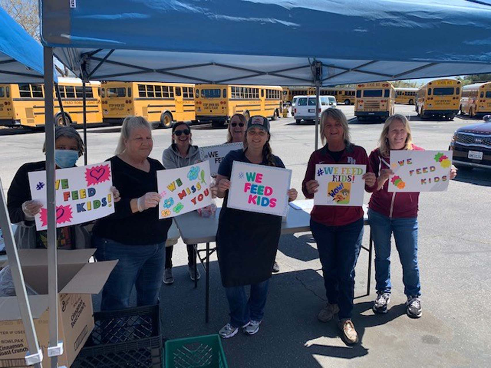 Paso Robles Joint Unified School District transportation staff assisting with meals. The districts meal delivery program started on March 18, when schools closed, and the department only took one week off this summer. (Photo courtesy of Paso Robles Joint Unified School District.)