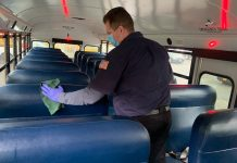A Suffolk Transportation employee on New York's Long Island cleans a school bus.