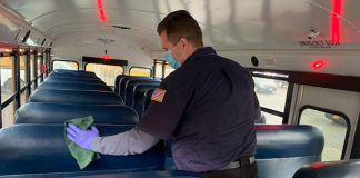 A Suffolk Transportation employee on New York's Long Island cleans a school bus.
