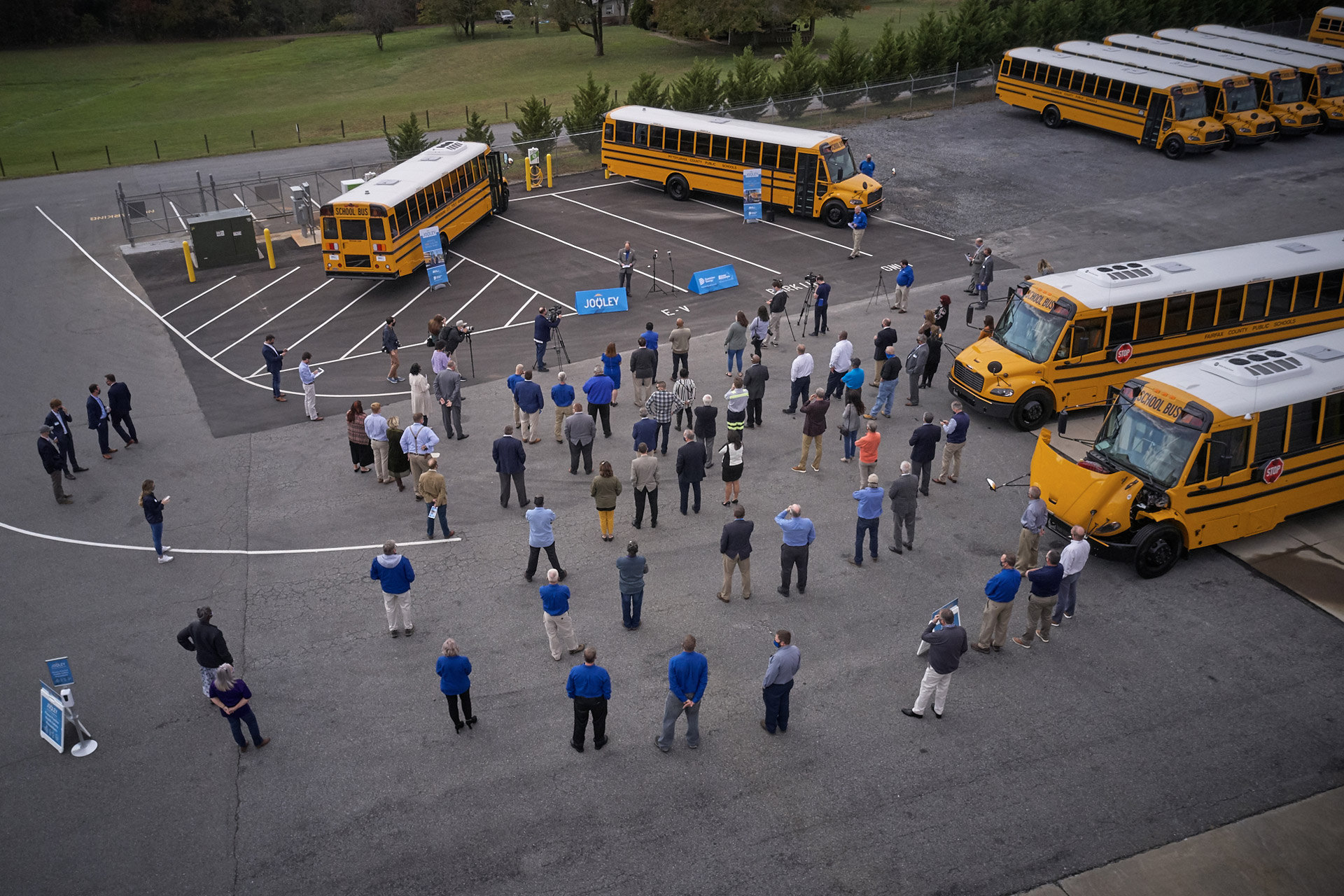 Representatives from Thomas Built Buses, Proterra, Dominion Energy, Sonny Merryman, and the Commonwealth of Virginia gather to celebrate the delivery of the first group of Saf-T-Liner C2 Jouley electric school buses delivered to Virginia schools as part of phase one of Dominion Energy's Electric School Bus Initiative.