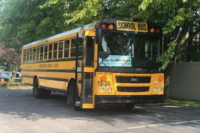 A Wayne-Westland Community School bus equipped provides a Wi-Fi hotspot for student virtual learning. (Photo courtesy Rhonda Lyons.)