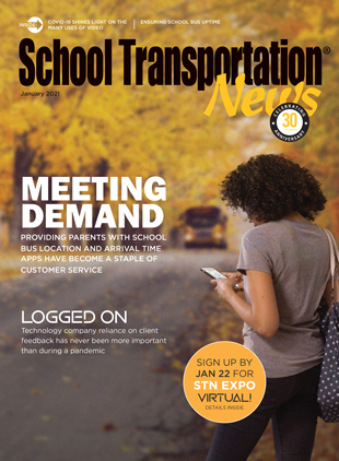 A parent checks the location of her child's school bus. Cover by Kimber Horne.