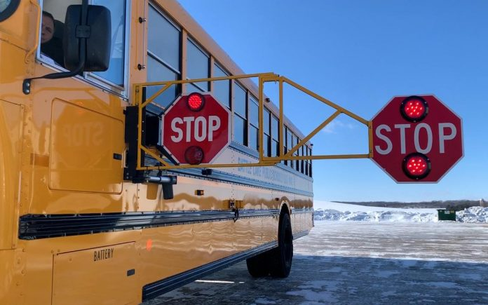Photo of the Extended Stop Arm in use on a Battle Lake, Minnesota school bus. (Photo courtesy of Bus Safety Solutions.)